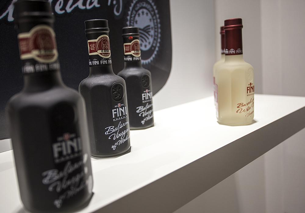 Bottiglie in esposizione allo stand Acetaia Fini al salone Cibus