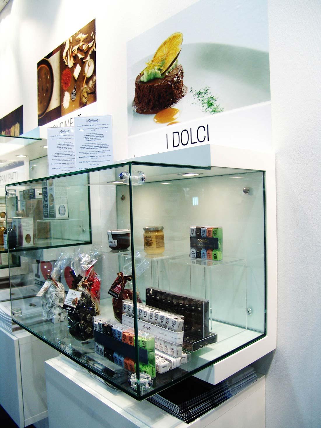Prodotti esposti in una vetrinetta nello stand Tartuflanghe allestito in occasione dell'esposizione internazionale Tuttofood 2013 al quartiere fieristico di Milano
