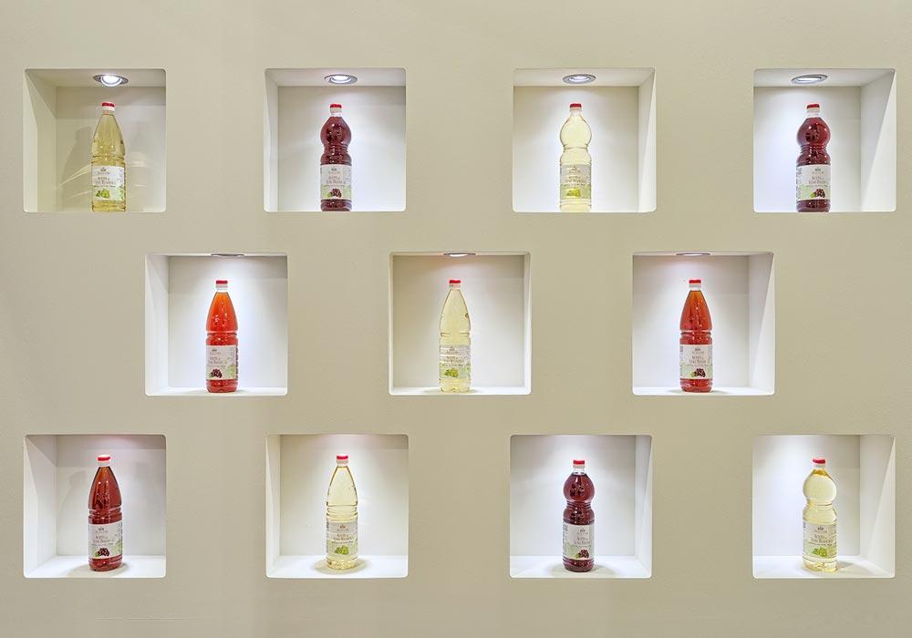 Bottiglie in esposizione nello stand dell'azienda Acetum allestito per il salone internazionale dell'alimentazione CIBUS che si tiene alla fiera di Parma.
